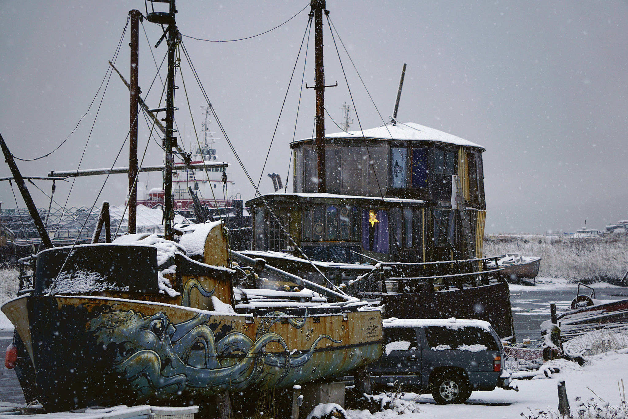 Snow falls on the Cape Lynch, right, and other boats on Sunday, Nov. 29, 2020, on the Homer Spit in Homer, Alaska. (Photo by Michael Armstrong/Homer News).
