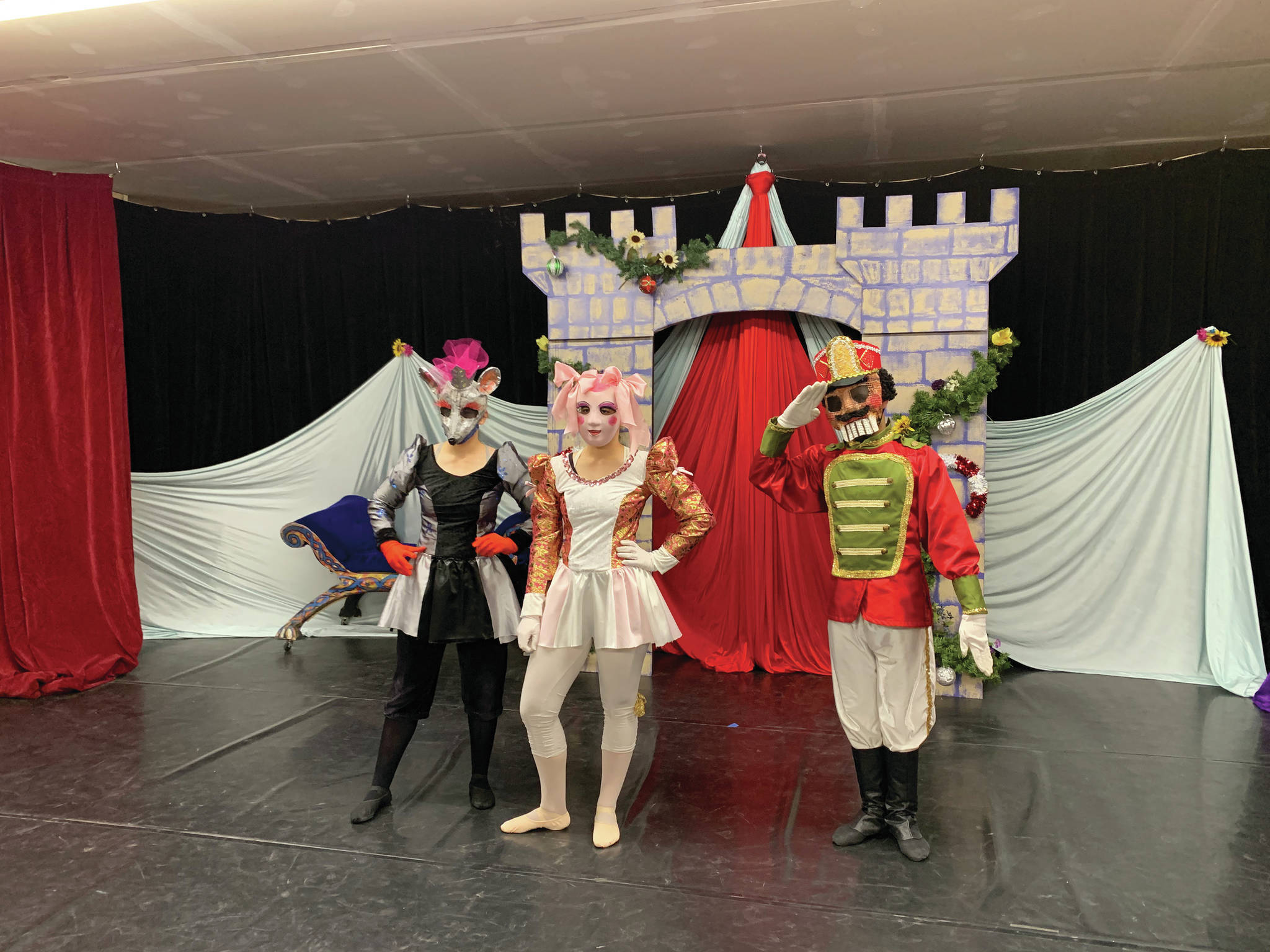 """Aletra Miller, Alexis Miller and Bryson Brewer-Dell on Dec. 3, 2020, pose for a photo in the """"Petite Nutcracker Ballet"""" at the Homer Nutcracker Productions' black box theater in the Wildberry Building in Homer, Alaska. (Photo by Jennifer Norton)"""