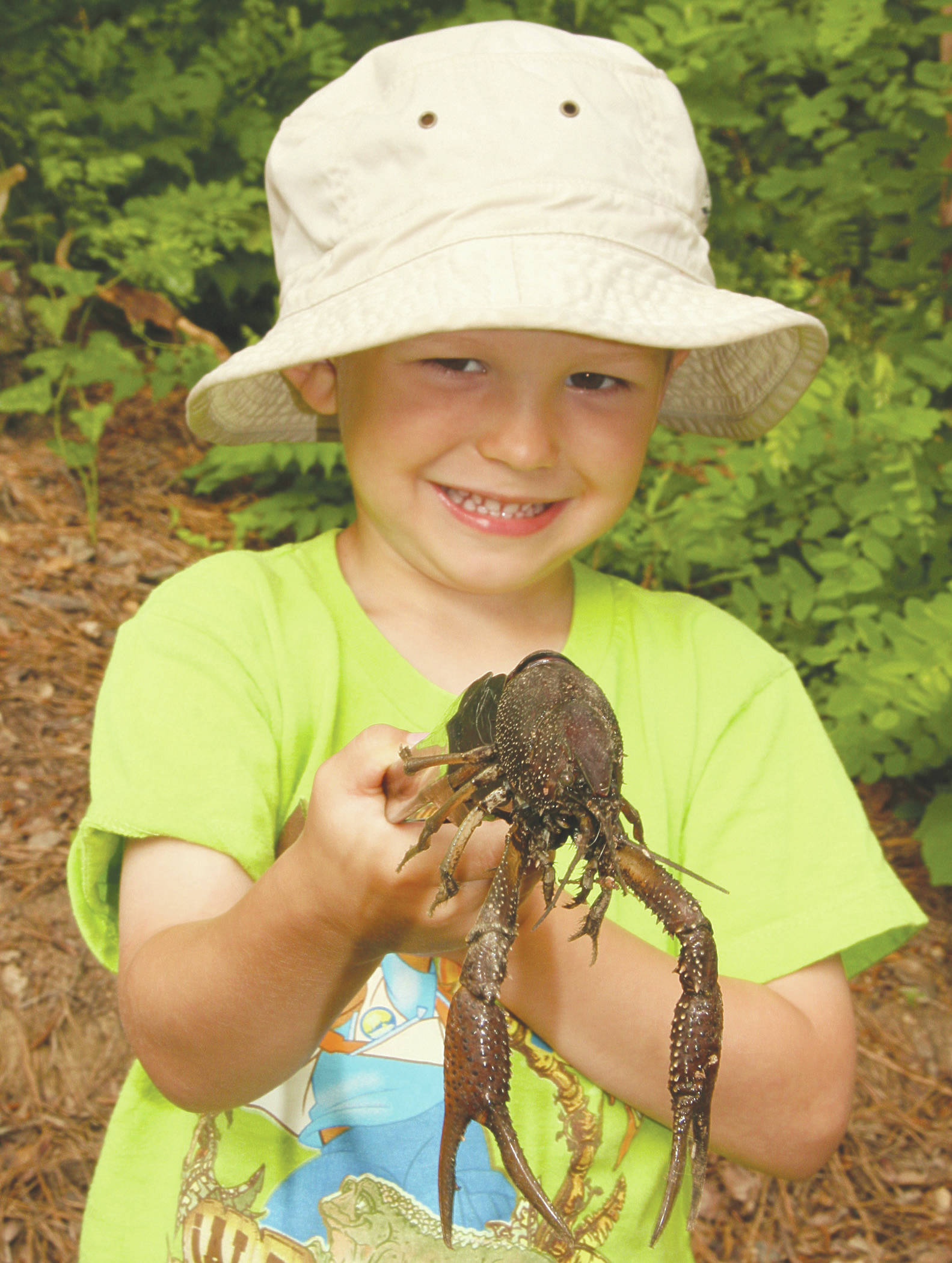 Wyatt, at age 4, helping dad harvest crawfish at White River NWR in Arkansas. (Photo by Matt Conner/USFWS)