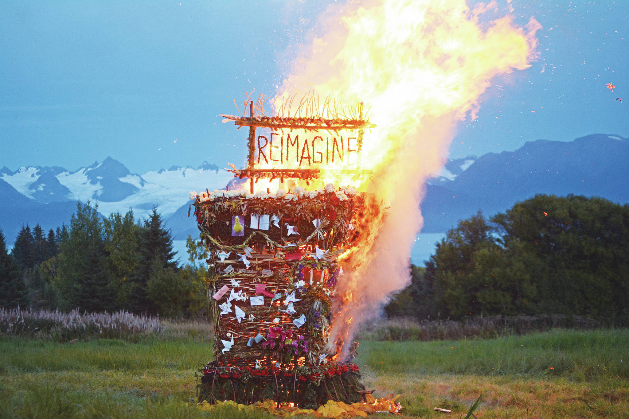 """""""Reimagine,"""" the 17th annual Burning Basket, catches fire in a field on Sunday, Sept. 13, near Homer. Artist Mavis Muller intended to broadcast live on Facebook and YouTube the burning of the basket, but because of technical difficulties that didn't happen. (Photo by Michael Armstrong/Homer News)"""