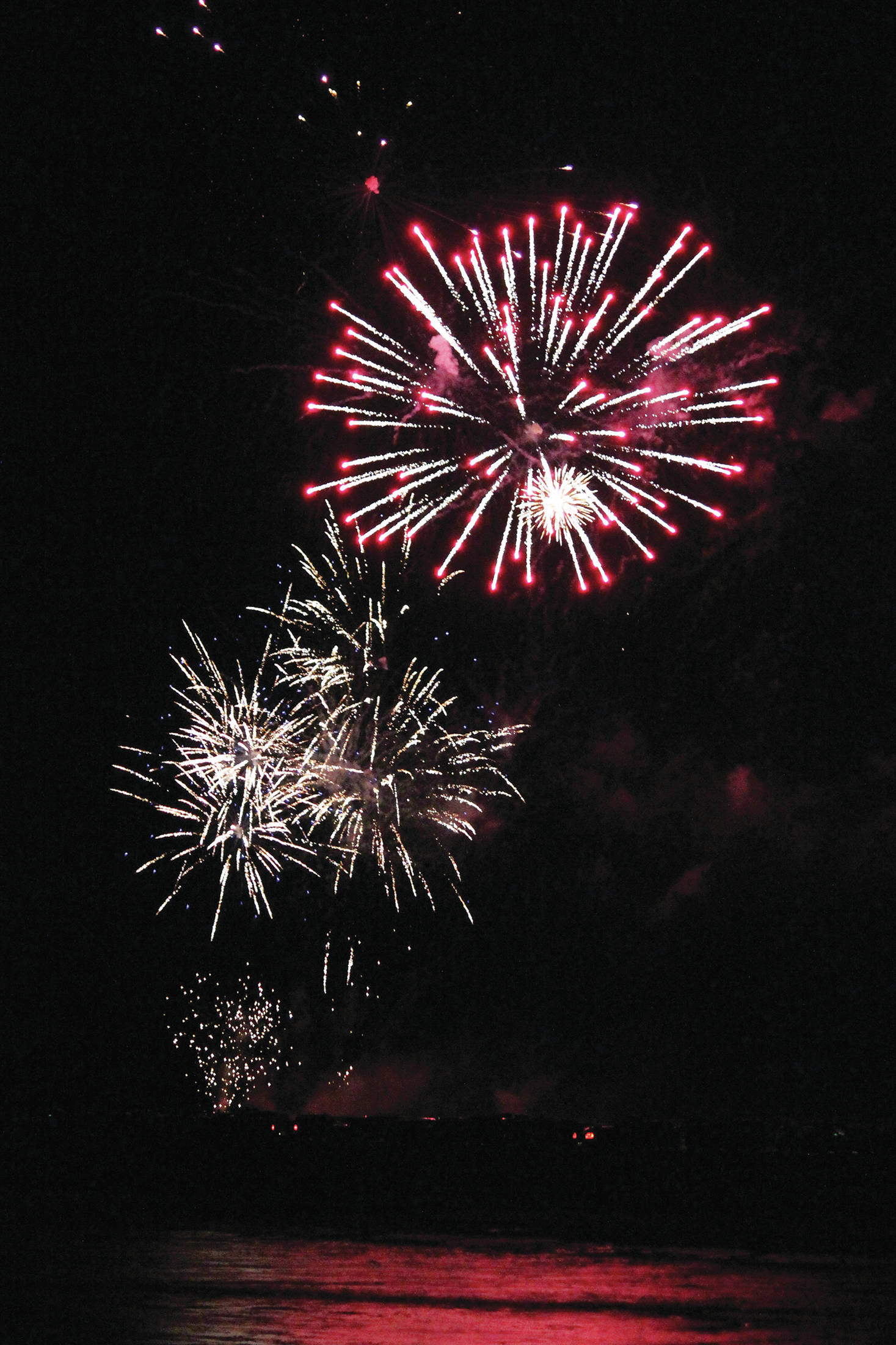 Fireworks explode above the Homer Spit on Dec. 31, 2020 as part of the third annual crowdfunded fireworks in Homer, Alaska. (Photo by Megan Pacer/Homer News)