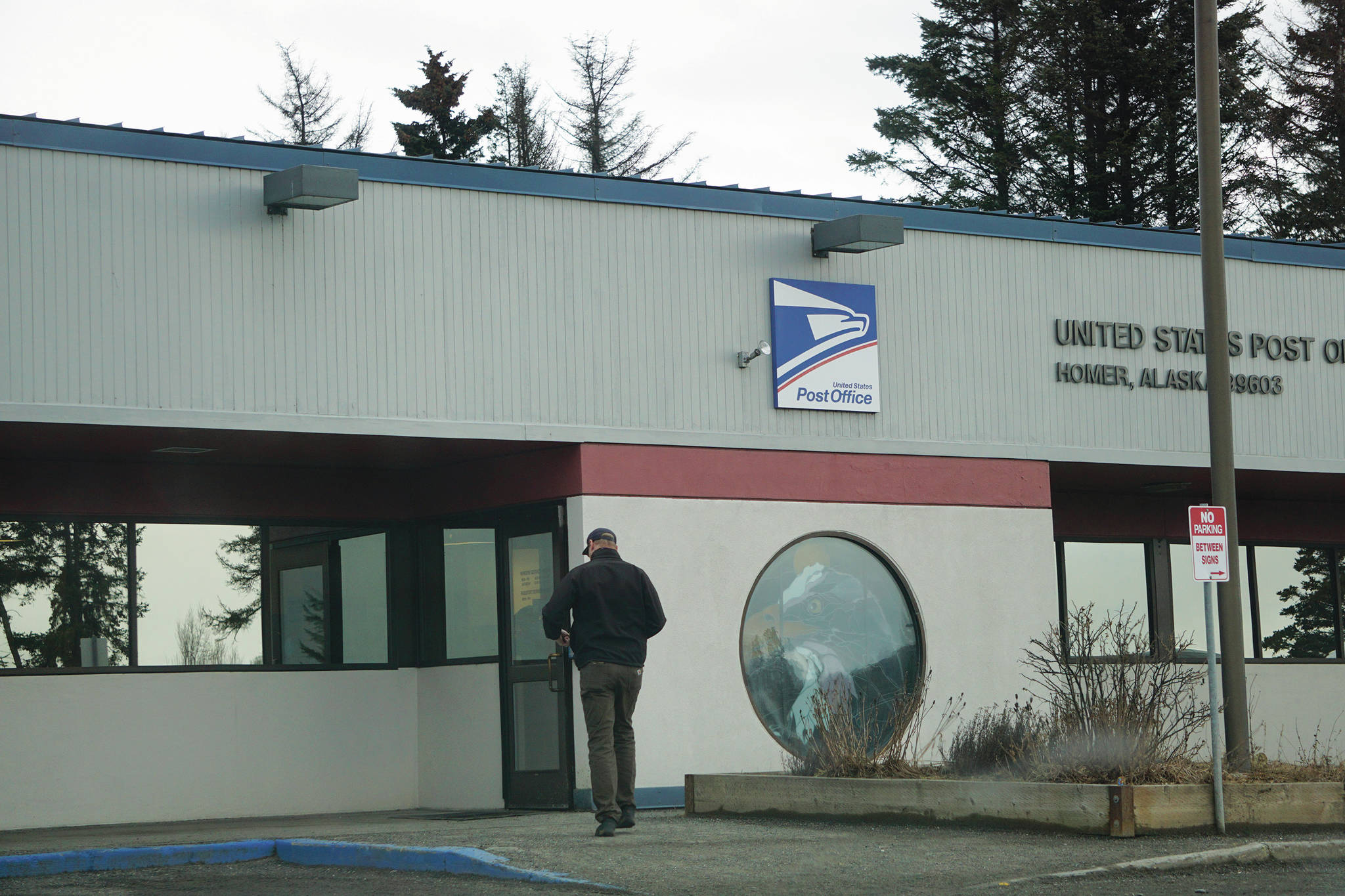 A man enters the Homer Post Office on Thursday, Jan. 21, 2021, in Homer, Alaska. On Jan. 20, 2021, President Joe Biden issued an executive order directing that federal employees and people in federal buildings should all wear masks. (Photo by Michael Armstrong/Homer News)