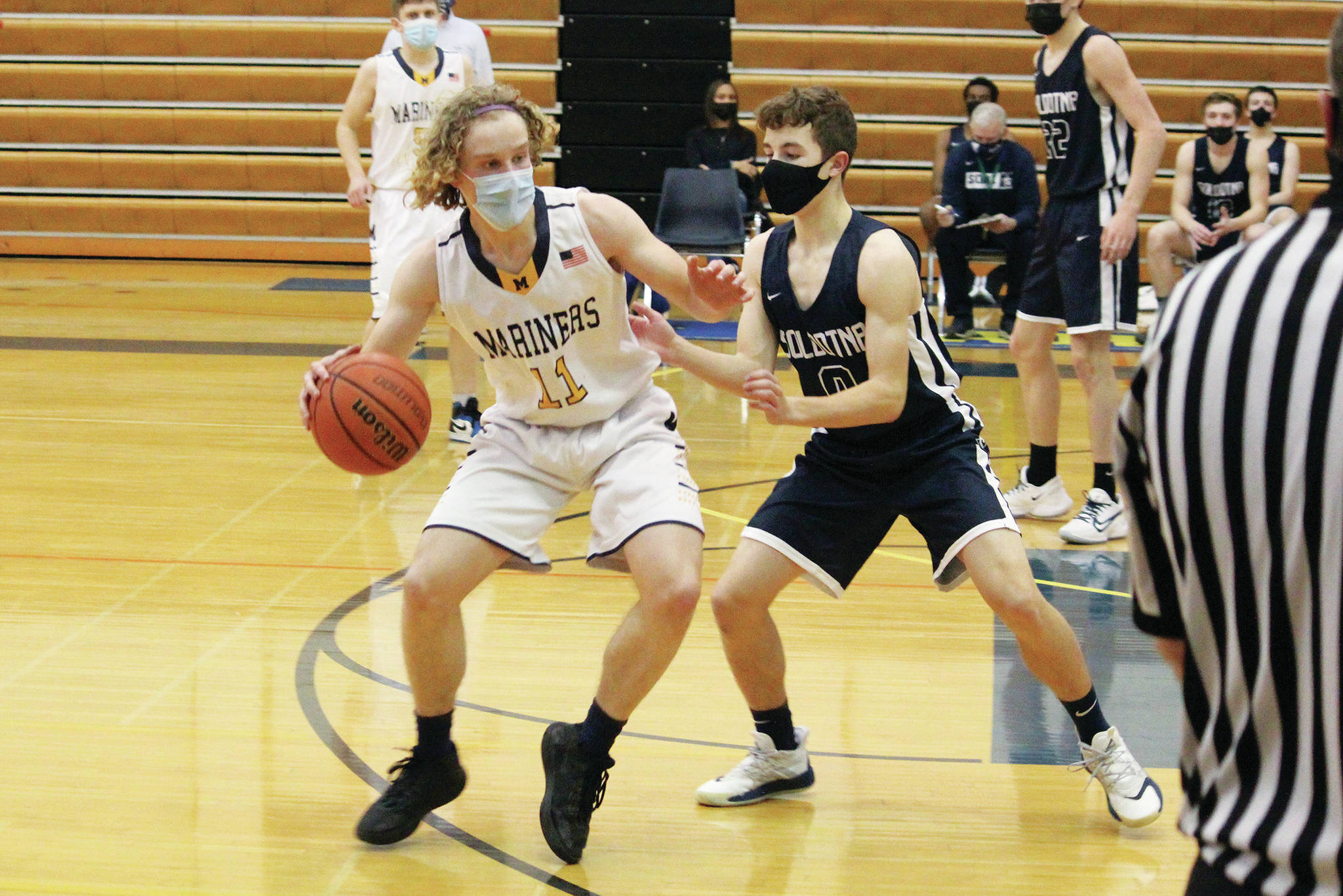 Soldotna's Zac Buckbee defends against Homer's Parker Lowney during a Tuesday, March 2, 2021 basketball game in the Alice Witte Gymnasium in Homer, Alaska. (Photo by Megan Pacer/Homer News)