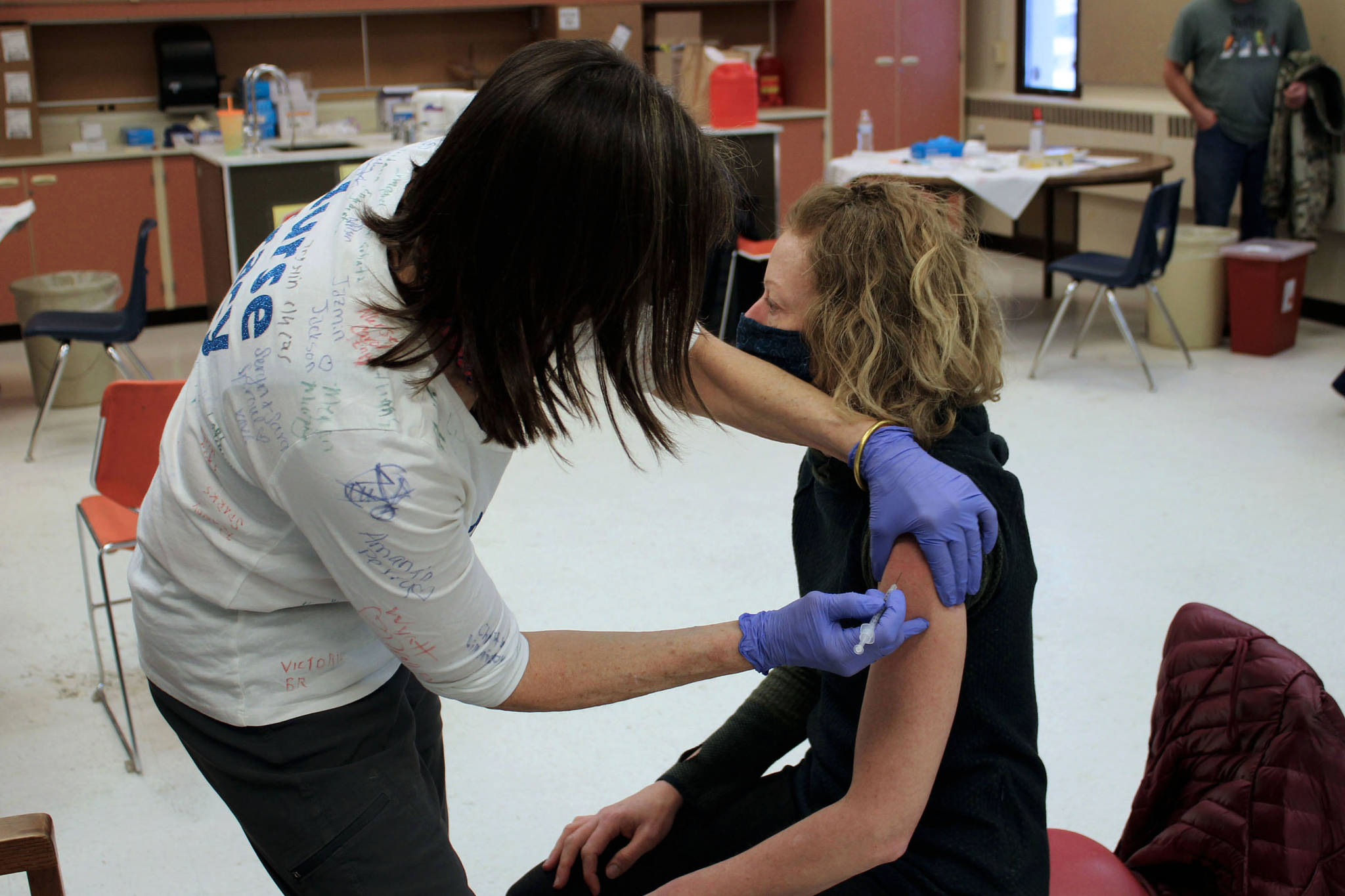 Tracy Silta (left) administers a dose of a COVID-19 vaccine to Melissa Linton during a vaccine clinic at Soldotna Prep School on Friday, Feb. 26, 2021, in Soldotna, Alaska. (Ashlyn O'Hara/Peninsula Clarion)