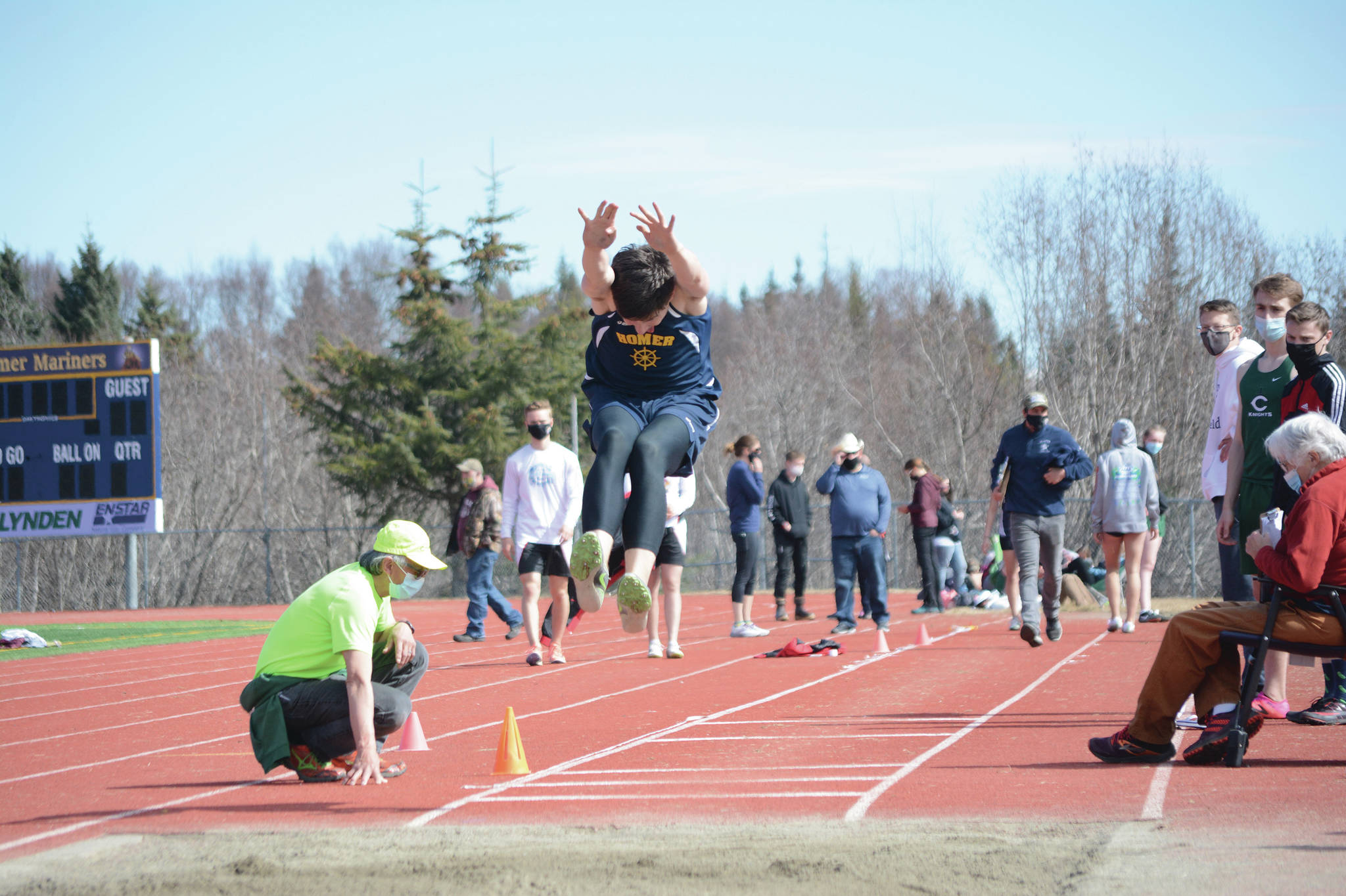 Homer High School Mariner Ryan Carroll competes in the long jump on Saturday, April 24, 2021, at Homer High School in Homer, Alaska. (Photo by Michael Armstrong/Homer News)