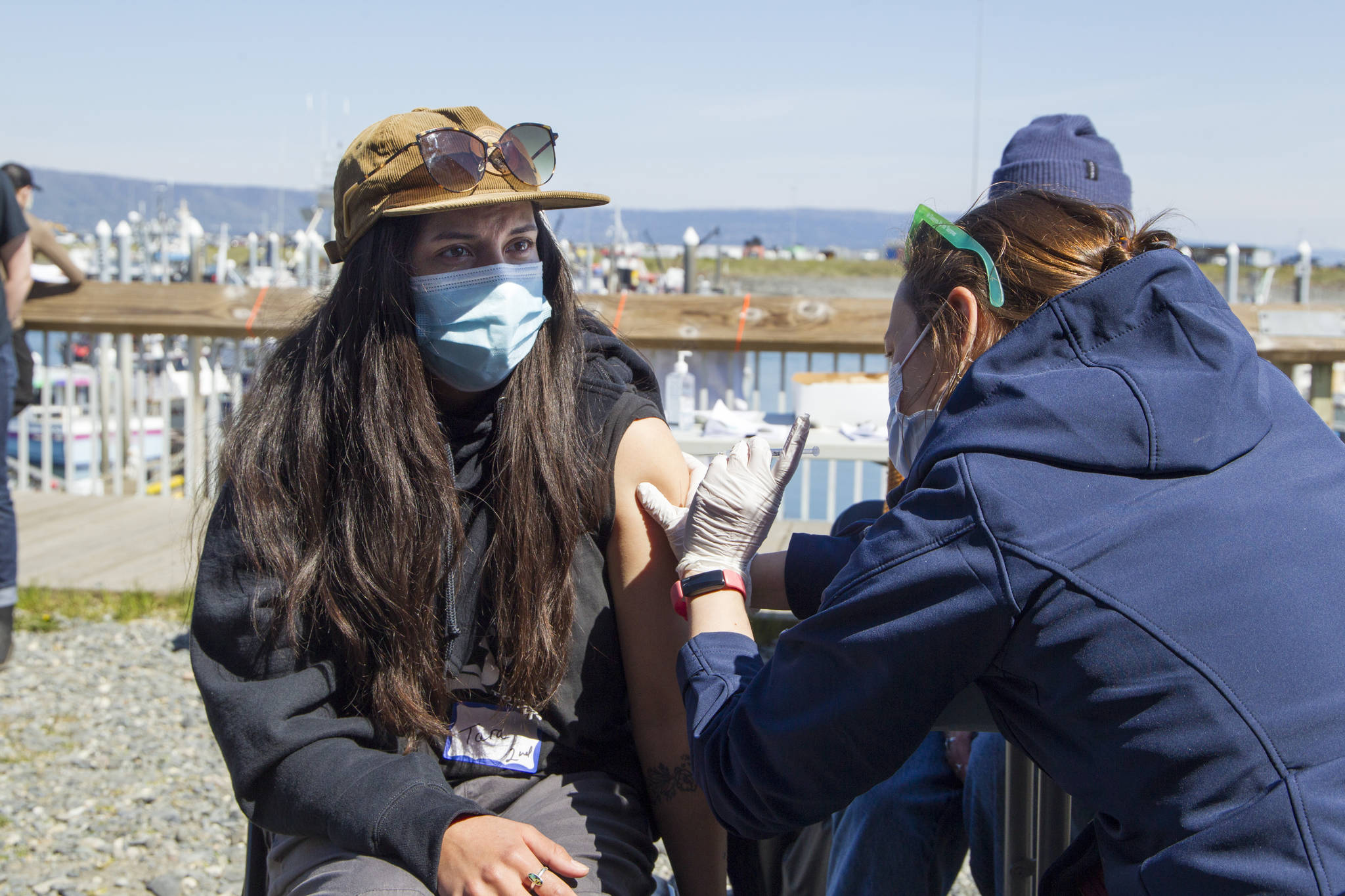 Tara Palacios receives her second COVID-19 vaccine during the pop-up clinic on the Spit May 27. (Photo by Sarah Knapp/Homer News)