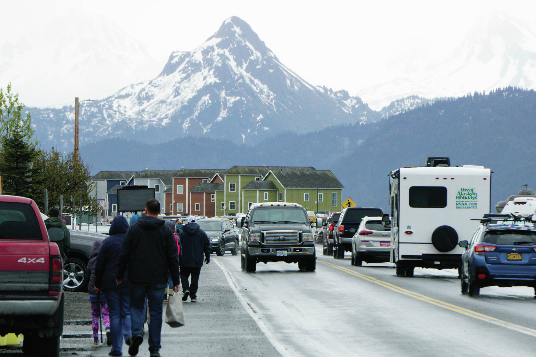Poot Peak looms over visitors to the Homer Spit on Saturday, May 29, 2021, in Homer, Alaska. (Photo by Michael Armstrong/Homer News)