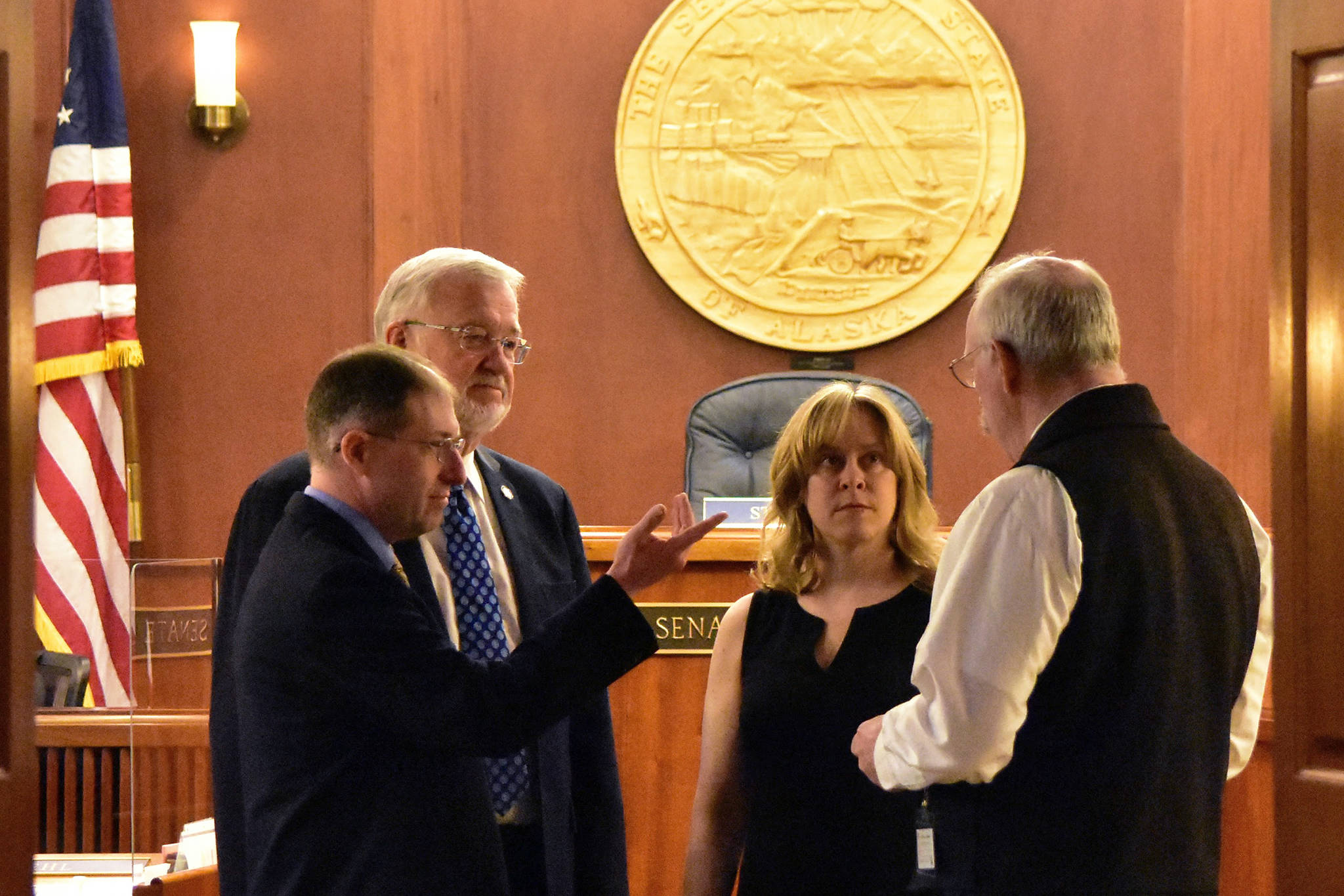 From left to right: Sens. Jesse Kiehl, D-Juneau; Gary Stevens, R-Kodiak; Mia Costello, R-Anchorage, and Bert Stedman, R-Sitka, speak on the floor of the Alaska Senate on Monday, May 24, 2021, the first day of one of two special sessions called by Gov. Mike Dunleavy. (Peter Segall / Juneau Empire)