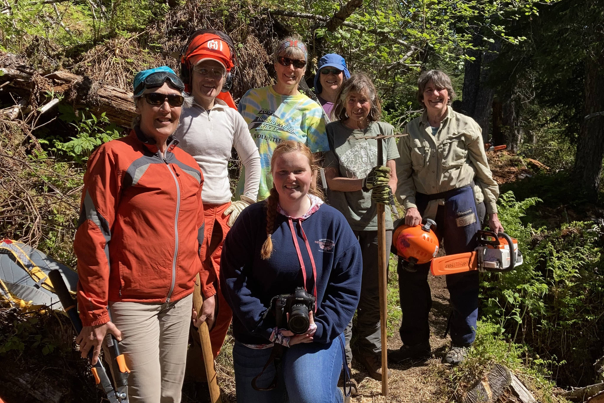 Homer News reporter Sarah Knapp (kneeling) is pictured with the Friends of Kachemak Bay State Park volunteer group who cleared South Eldred Trail during National Trails Day on June 5. The group was able to clear half a mile of the trail. Pictured left to right are Kristine Moerlein, Amy Holman, Kathy Sarns, Lyn Maslow, Ruth Dickerson and Kris Holderied. (Photo by Michael Singer)