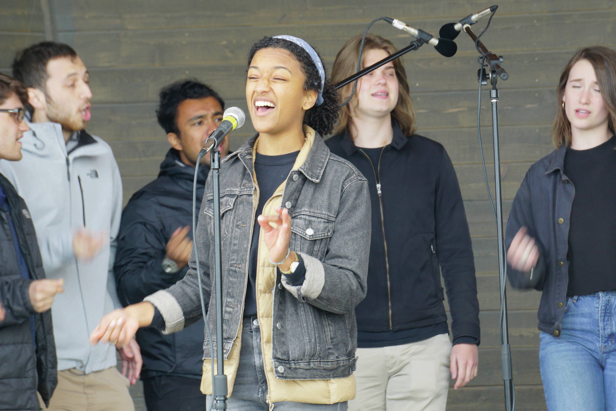 Morgan Baker, center, sings a solo with the rest of the Yale University Whiffenpoofs backing her at a concert Thursday, July 8, 2021, at the Boathouse Pavillion in Homer, Alaska. The group also did a workshop Thursday at the Homer Council on the Arts. (Photo by Michael Armstrong/Homer News)