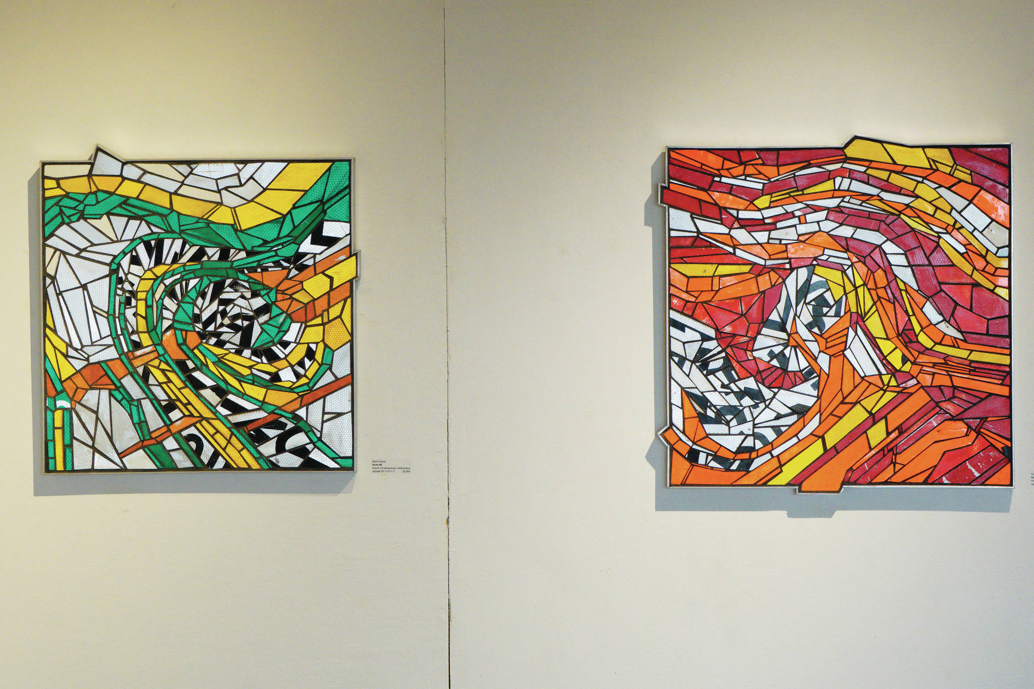 """Sheila Wyne's """"Strata #8,"""" left, and """"Strata #9,"""" right, are part of her show that opened Friday, Aug. 6, 2021, at Bunnell Street Arts Center. (Photo by Michael Armstrong/Homer News)"""