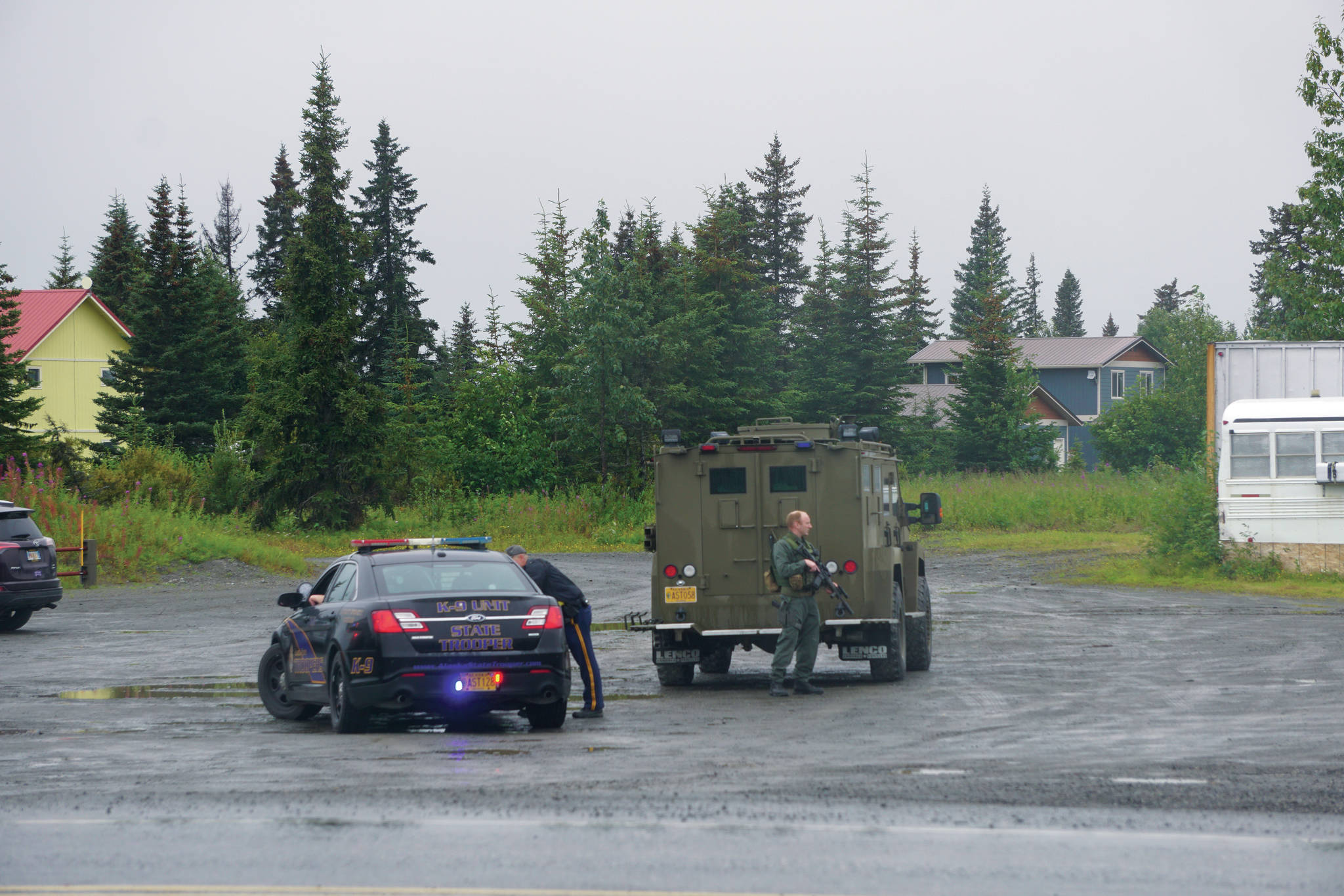 Alaska State Troopers and members of the Special Emergency Reaction Team respond at a shooting scene on Monday, Aug. 23, 2021, at the Anchor Point Warehouse in Anchor Point, Alaska, on the Sterling Highway. An Alaska State Trooper was shot and is in fair condition at an Anchorage hospital. Troopers arrested the suspect, Bret Herrick, 60, on Tuesday morning, Aug. 24, 2021. (Photo by Michael Armstrong/Homer News)