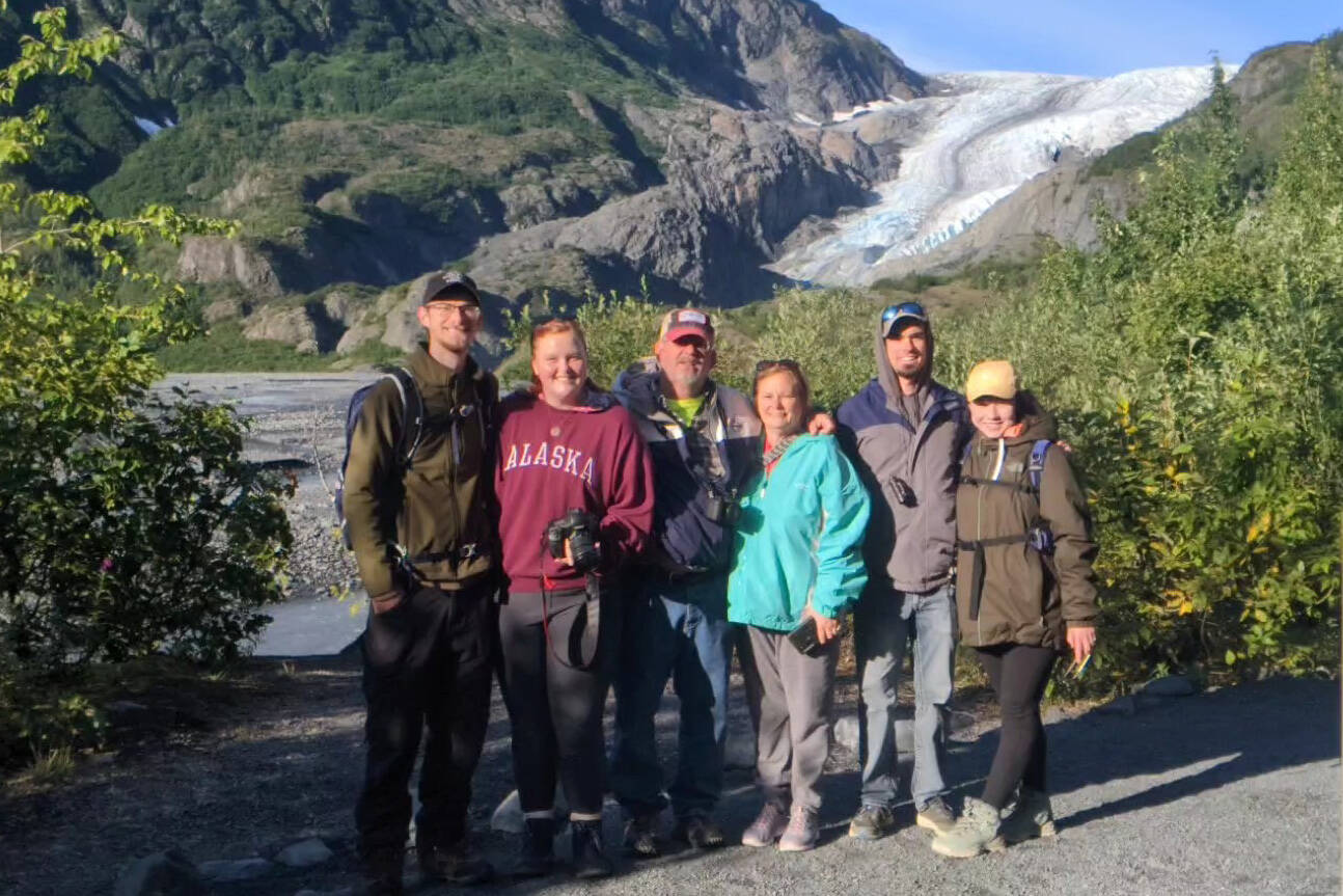 Michael, Sarah, Pete, Becky, Will and Margaret take a picture in front of Exit Glacier in Seward on Aug. 21.