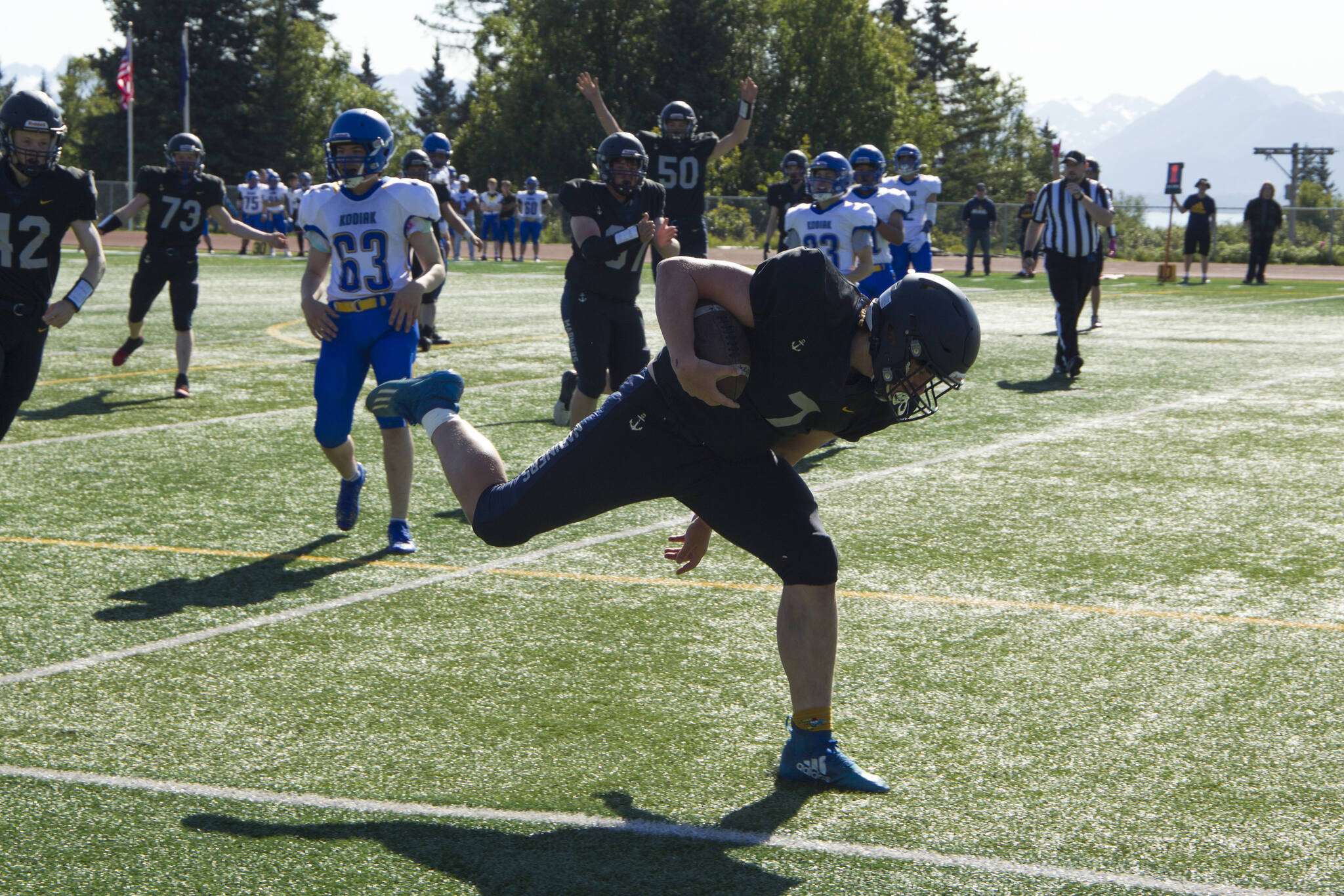 Carter Tennison scores a touchdown for the Homer Mariners against Kodiak High School on Saturday, Aug.28. The Mariners won 34-0. (Photo by Sarah Knapp/Homer News)