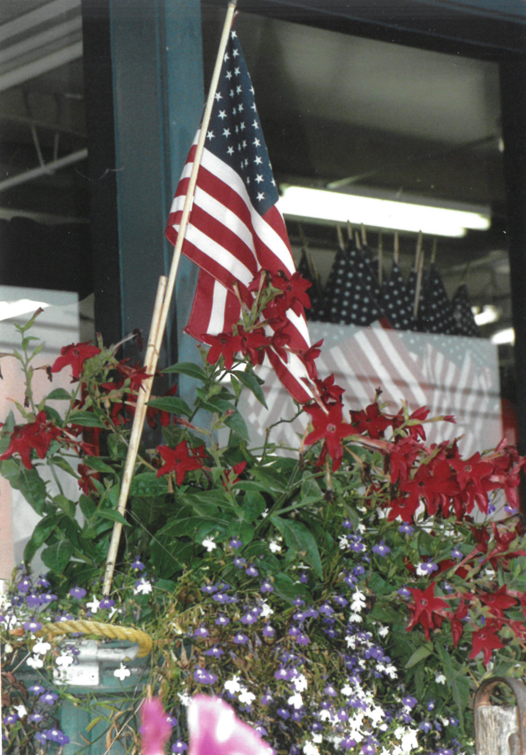 Twenty years ago after the attacks of Sept. 11, 2001, displays of U.S. flags were common, as seen here at NOMAR in Homer the week after the attacks. (Homer News file photo)