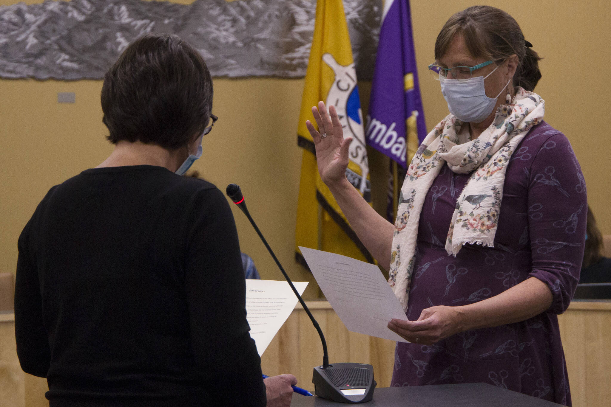 Donna Aderhold recites the Homer City Council oath of office and is sworn in for duty at the city council meeting on Oct. 11. (Photo by Sarah Knapp/Homer News)